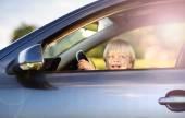Little boy having fun time driving a car — Foto de Stock