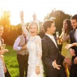 Newlywed couple dancing with bridesmaids and groomsmen — Stock Photo #62139433