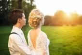 Wedding couple in summer park — Stock Photo