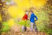 Active seniors having walk with bikes — Stock Photo