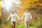 Active seniors having fun in autumn forest — Stock Photo