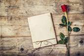 Blank love letter and red rose. — Stock Photo