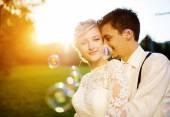 Wedding couple enjoying romantic moments — Stock Photo