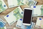 Smartphone and European currency banknotes — Stock Photo