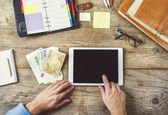 Mix of office supplies, gadgets and money — Stock Photo