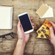 Desktop mix with gadget, supplies and pizza — Stock Photo #64575339