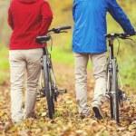Senior couple having walk with bikes — Stock Photo #64575437