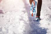 Sportsman jogging in winter park — Stock Photo