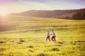 Couple having fun on a meadow — Stock Photo