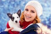 Woman having fun with her dog puppy — Stockfoto