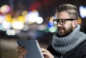 Hipster man using digital tablet — Stock Photo