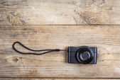 Old camera on wooden desk — Stock Photo