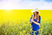 Girl in colza field — Stock Photo