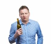 Drunk man holding a beer bottle — Stock Photo