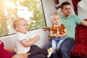 Family with two sons in train. — Stock Photo