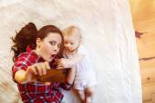 Little baby girl and her mother taking selfie — Stock Photo