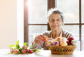 Senior woman with easter eggs — Stock Photo
