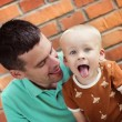 Father and son making funny faces — Stock Photo #68963575