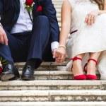 Wedding couple holding hands — Stock Photo #68964321