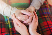 Grandmother and granddaughter holding hands. — Stock Photo