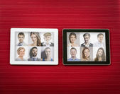 Tablet with female and male portraits — Stock Photo