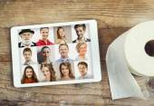 Digital tablet with group of people's portraits — Stock Photo