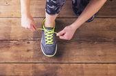 Runner tying her shoelaces. — Stock Photo