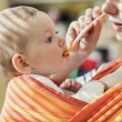 Mother feeding her daughter — Stock Photo #70886689
