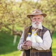 Farmer with milk bottles — Foto de Stock   #71434917