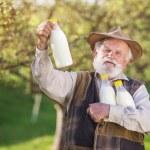 Farmer with milk bottles — Stock Photo #71434919