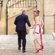 Young wedding couple  on the stairs — Stock Photo #71509061