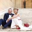 Young wedding couple on the stairs — Stock Photo #71509177