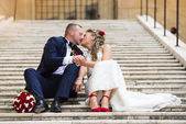Young wedding couple on the stairs — Stock Photo