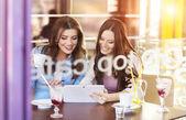 Beautiful women using digital tablet — Stock Photo
