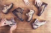 Hands holds Hiking shoes — Stock Photo