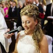 Bride during a mass in the church — Stock Photo #72523253