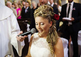 Bride during a mass in the church — Stock Photo