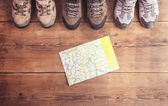 Hiking shoes and map — Stock Photo