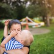 Mother and son together outside — Stock Photo #73047031