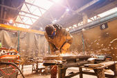 Man welding in a factory — Stock Photo