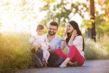 Happy family having fun in spring