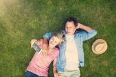Beautiful seniors lying on a grass — Stock Photo