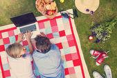 Beautiful seniors with notebook having a picnic — Foto de Stock