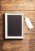 White picture frame and empty tag — Stock Photo