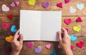 Empty sheet of paper and fabric hearts — Stock Photo