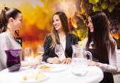 Three girls in bar — Stock Photo