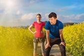 Couple running in field — Stock Photo