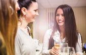 Three girls in bar — Stock Photo