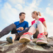 Young runners taking a break — Stock Photo #76699341