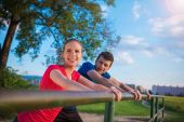 Runners  warming up and stretching — Stock Photo